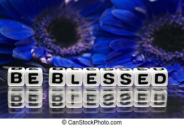Be blessed message with blue flowers in the background.