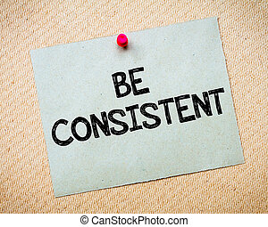 Be Consistent Message. Recycled paper note pinned on cork board. Concept Image