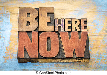 Be here now word abstract in wood type - Be here now - word...
