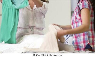 Be in - Tilt up of girls trying on the dresses