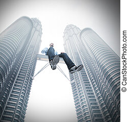 be leader - man sit on skyscrape bridge