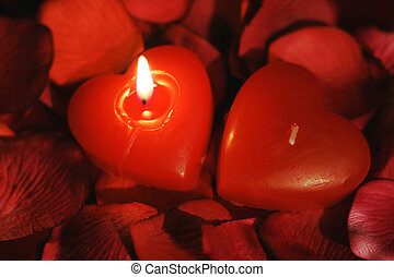 Be my valentine - Two heart-shaped candles, one burning for...