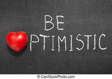 be optimistic phrase handwritten on blackboard with heart symbol instead of O