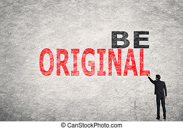 Be Original - Asian businessman write text on wall, Be...