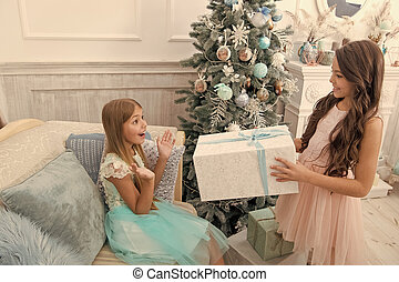Be positive. Child enjoy the holiday. Christmas tree and presents. Happy new year. Winter. xmas online shopping. Family holiday. The morning before Xmas. Little girls