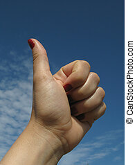 Be positive - Hands of a women holding up thumbs symbolizing...
