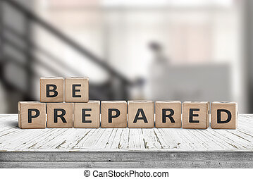 Be prepared phrase on wooden dices in a bright room on an ...