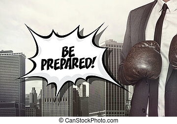 Be prepared text with businessman wearing boxing gloves