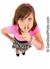 Beautiful 10 year old girl making hush gesture looking up at camera. Top view over white background.
