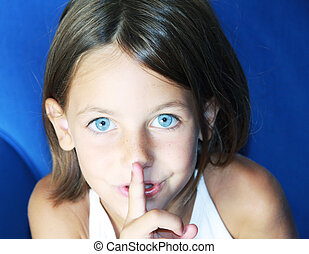 be quiet gesture - a caucasian child with her forefinger to...