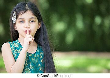 Be quiet mister - Closeup portrait, young girl placing...