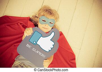 Be super - Superhero child holding LIKE sign. Social media...