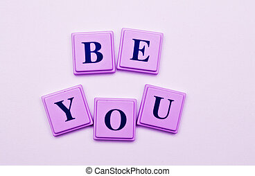 Be You spelled out in colored blocks