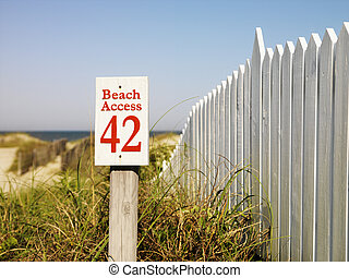 Beach access. - Beach access sign with picket fence at Bald...