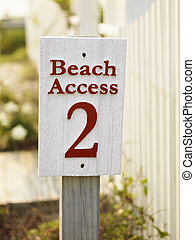 Beach access sign. - Sign for public beach access number...