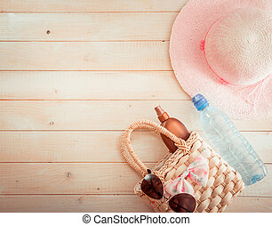 beach accessories on a wooden background