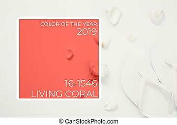 Beach accessories on the white background. Living coral theme - color of the year 2019