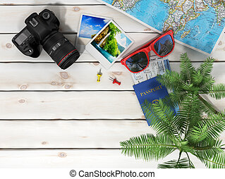 Beach accessories on the wood background.
