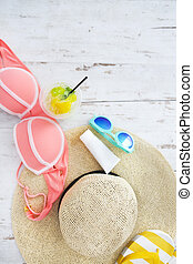 Beach accessories on white wooden background