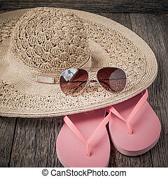 beach accessories on wooden board background