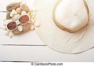 beach accessories on wooden board