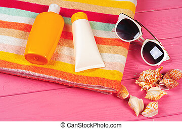 Beach accessories with sea shells on wooden background