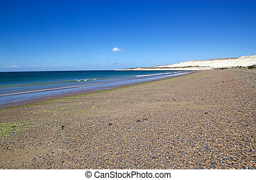 The beach after Punta Loma near Puerto Madryn, a city in Chubut Province In Patagonia, Argentina. Puerto Madryn is protected by the Golfo Nuevo, which is formed by the Peninsula Valdes and the Punta Ninfas