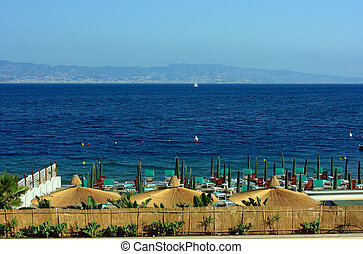 Beach against Sicily - Beach in Reggio Calabria with the...