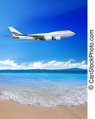 beach and blue sky with plane