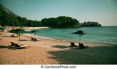Beach and famous island Sveti Stefan in Montenegro - Famous...