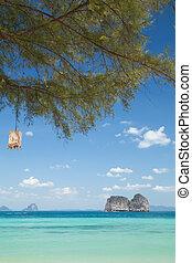 Beach and island with sunny sky, summer paradise, summer travel