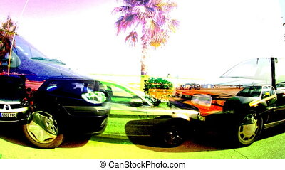 beach and parked cars shot form a moving motorbike in sitges, spain