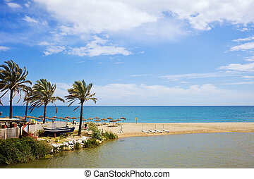 Summer vacation beach and sea scenery on Costa del Sol in Spain, located between Marbella and Puerto Banus, waters of Green River (Spanish: Rio Verde) and Mediterranean Sea.