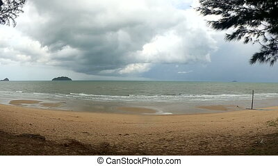 Beach and storm sky over the sea