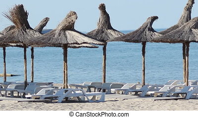 Beach and Sunbeds - Relaxing view of the thatched parasols...
