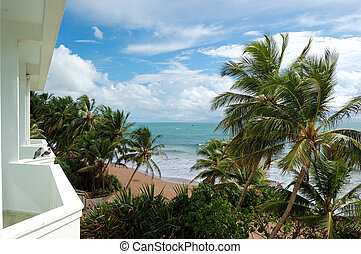 Beach and turquoise water of Indian Ocean, Bentota, Sri Lanka