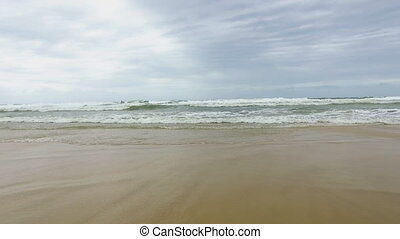 Beach and waves lapping onto shore