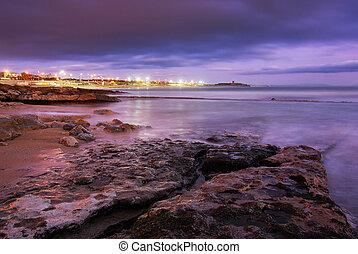 Beach at dusk - Beach landscape at dusk in Carcavelos area, ...