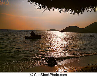 Beach at dusk with a small boat