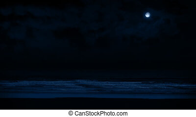 Beach At Night In Moonlight - Wide shot of beach shore with...