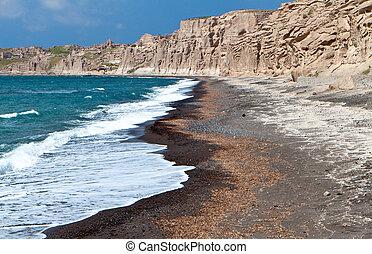 Beach at Santorini island, Greece - Beach of Vlychada at...