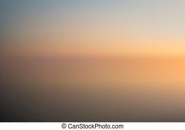 beach at sunset blurred background