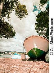 Beach Background. Boat on the beach.