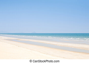 Beach background with clean sand and blue sky