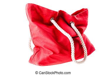 Beach bag - a beautiful purse isolated over a white ...