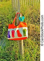 Beach bag - A colorful beach bag hanging on a fist ...