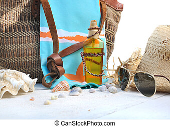 beach bag and accessories on white wooden plank  with shells