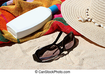 sun block - beach bag and beach items and sun block