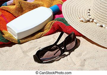 sun block - beach bag and beach items and sun block