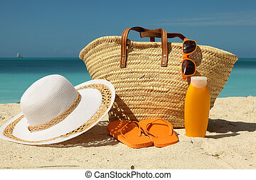 beach bag and sun protection on sand
